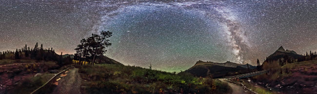 ADY200265S © Stocktrek Images, Inc. Panorama of Milky Way over Red Rock Canyon in Alberta, Canada.