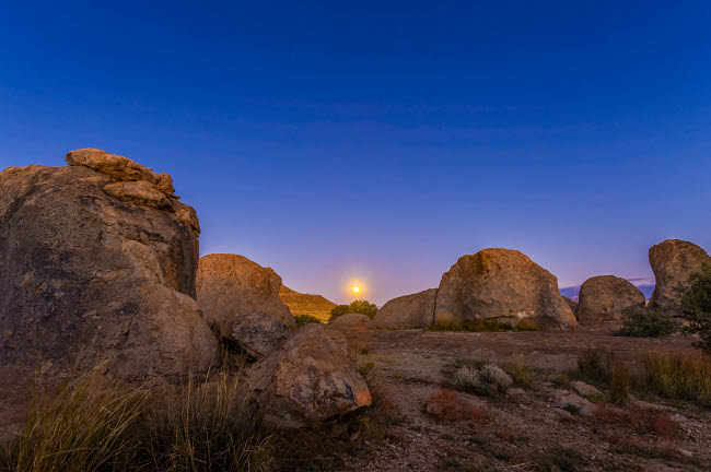 ADY200277S © Stocktrek Images, Inc. Full moonrise at City of Rocks State Park, New Mexico.