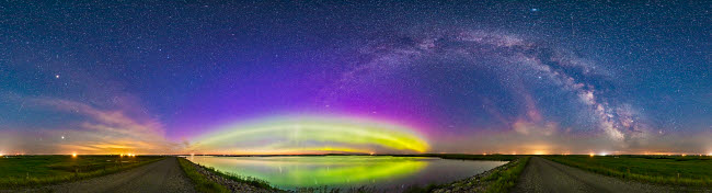 ADY200364S © Stocktrek Images, Inc. The arc of the northern lights and auroral oval over Crawling Lake, Alberta, Canada.