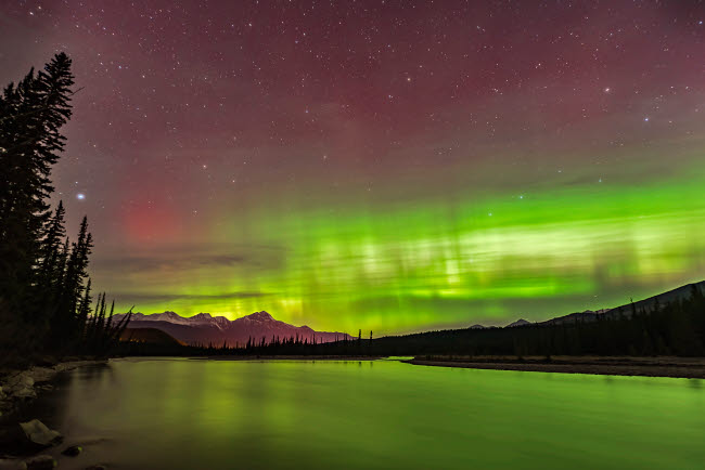ADY200369S © Stocktrek Images, Inc. The northern lights over the Athabasca River in Jasper National Park, Alberta, Canada.