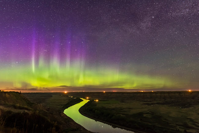 ADY200371S © Stocktrek Images, Inc. The northern lights dance over the Red Deer River and Badlands of Alberta, Canada.