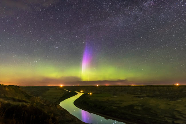 ADY200372S © Stocktrek Images, Inc. The lone curtain of purple and blue aurora over Red Deer River, Alberta, Canada.