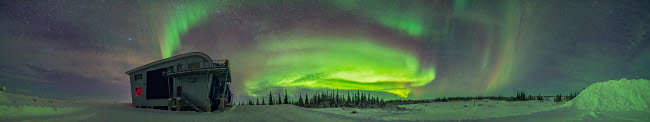 ADY200373S © Stocktrek Images, Inc. Panorama of auroral arcs on the shore of Hudson Bay, Canada.