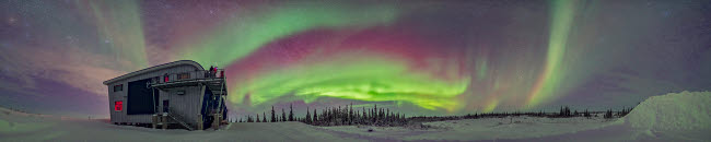 ADY200374S © Stocktrek Images, Inc. Panorama of auroral arcs on the shore of Hudson Bay, Canada.