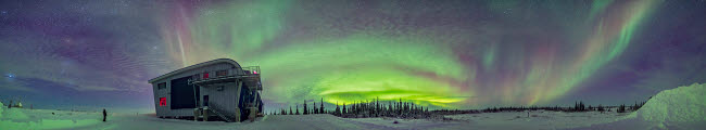 ADY200375S © Stocktrek Images, Inc. Panorama of auroral arcs on the shore of Hudson Bay, Canada.