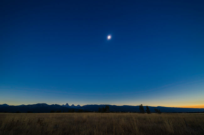 ADY200405S © Stocktrek Images, Inc. Total solar eclipse over the Grand Tetons in Idaho.
