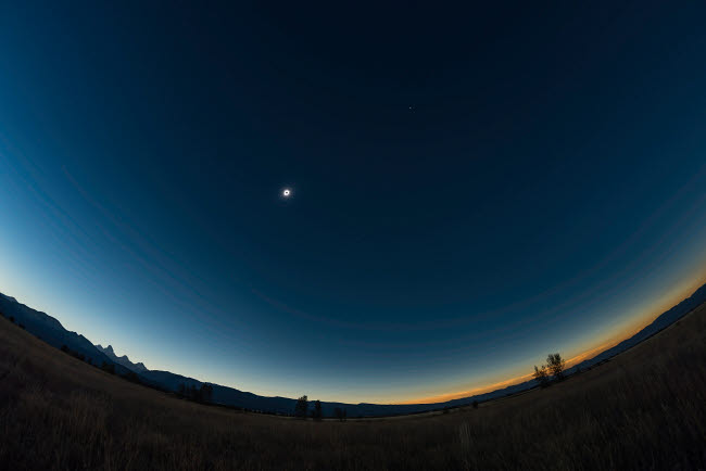 ADY200406S © Stocktrek Images, Inc. An ultra-wide angle view of the total eclipse sky from the Teton Valley, Idaho.