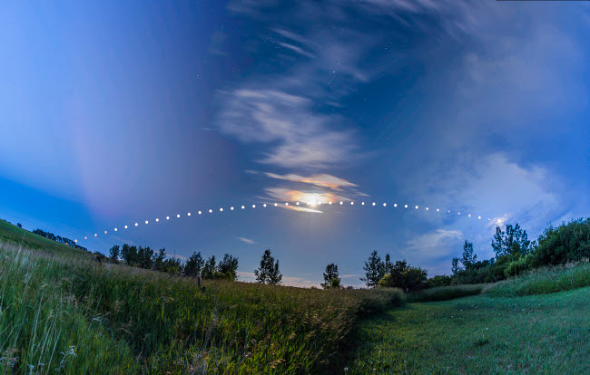 ADY200417S © Stocktrek Images, Inc. Arc of the Summer Moon in Alberta, Canada.