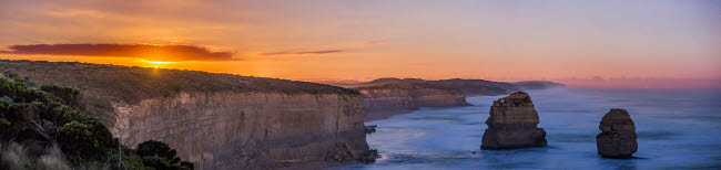 ADY200437S © Stocktrek Images, Inc. The nearly full moon rising over the sea cliffs near Port Campbell, Australia.