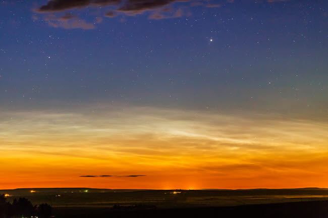 ADY200441S © Stocktrek Images, Inc. Noctilucent clouds on the horizon in Alberta, Canada.