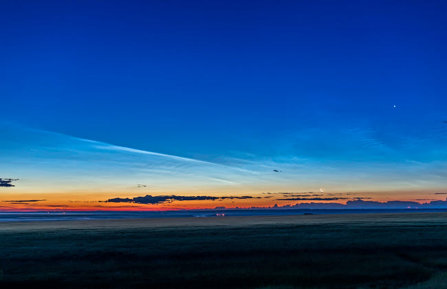ADY200442S © Stocktrek Images, Inc. Noctilucent clouds at dawn with the moon and Venus.