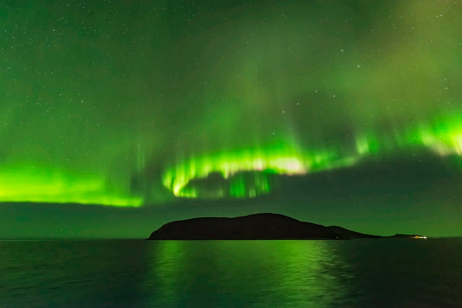 ADY200443S © Stocktrek Images, Inc. The northern lights over an island in Norway.