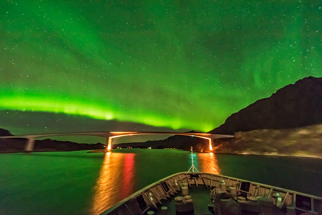 ADY200444S © Stocktrek Images, Inc. The aurora boralis over a bridge in Norway.