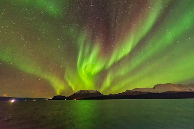ADY200446S © Stocktrek Images, Inc. The northern lights with red color in upper curtains, Norway.