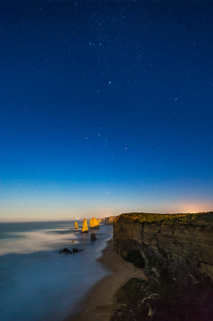 ADY200453S © Stocktrek Images, Inc. The stars of Orion and Canis Major over Twelve Apostles, Australia.