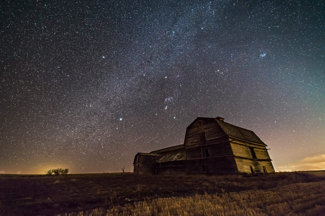 ADY200461S © Stocktrek Images, Inc. Orion and the winter Milky Way over an old barn in Alberta, Canada.