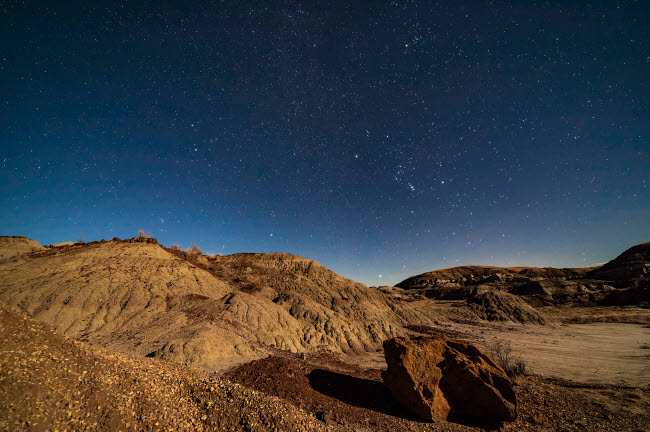 ADY200462S © Stocktrek Images, Inc. Orion and the winter stars rising over Dinosaur Provincial Park, Alberta, Canada.
