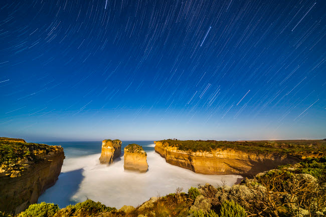 ADY200464S © Stocktrek Images, Inc. Orion and Sirius setting into the west over Loch Ard Gorge, Australia.