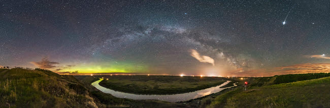 ADY200466S © Stocktrek Images, Inc. The Milky Way arching over the scenic bend of the Red Deer River, Alberta, Canada.