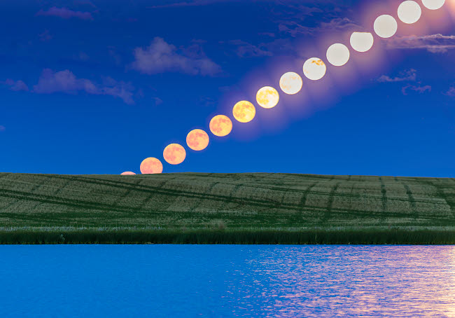 ADY200480S © Stocktrek Images, Inc. Time lapse of a full moon rising over a prairie pond in Alberta, Canada.