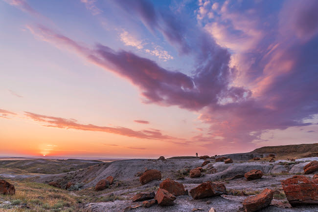 ADY200505S © Stocktrek Images, Inc. A colorful sunset at the Red Rock Coulee Natural Area in southeast Alberta, Canada.
