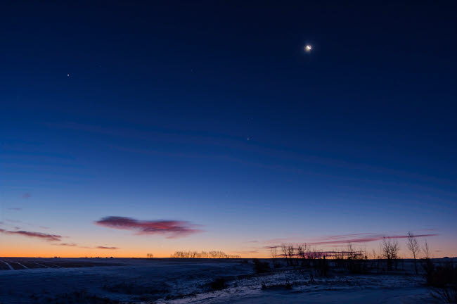 ADY200522S © Stocktrek Images, Inc. Venus and Jupiter in close conjunction very low in the southeast sky, Alberta, Canada.