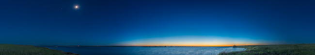 ADY200533S © Stocktrek Images, Inc. Panorama of the waxing gibbous moon over Lake MacGregor in Alberta, Canada.