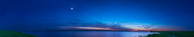 ADY200534S © Stocktrek Images, Inc. Panorama of the waxing crescent moon over Lake MacGregor in Alberta, Canada.