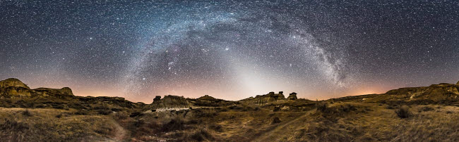 ADY200541S © Stocktrek Images, Inc. Milky Way arches across the sky at Dinosaur Provincial Park, Alberta, Canada.
