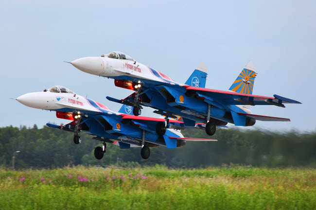 ANK100007M © Stocktrek Images, Inc. Pair of Su-27 jet fighters of the Russian Knights aerobatics team taking off.