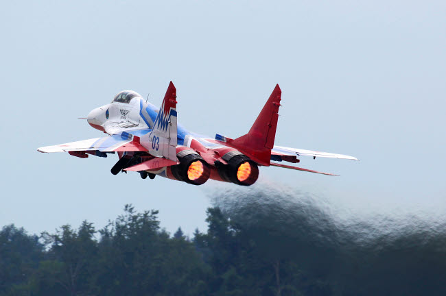 ANK100008M © Stocktrek Images, Inc. MiG-29 jet fighter of Swifts Russian aerobatics team taking off.