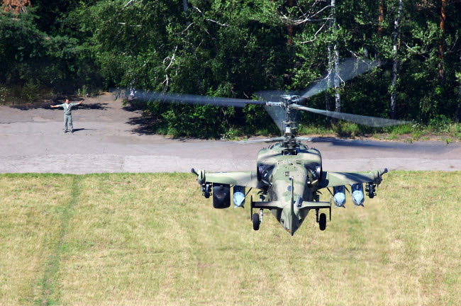 ANK100010M © Stocktrek Images, Inc. Ka-52 Alligator attack helicopter of the Russian Air Force landing in a field.