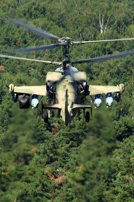 ANK100011M © Stocktrek Images, Inc. Ka-52 Alligator attack helicopter of the Russian Air Force flying over treetops.