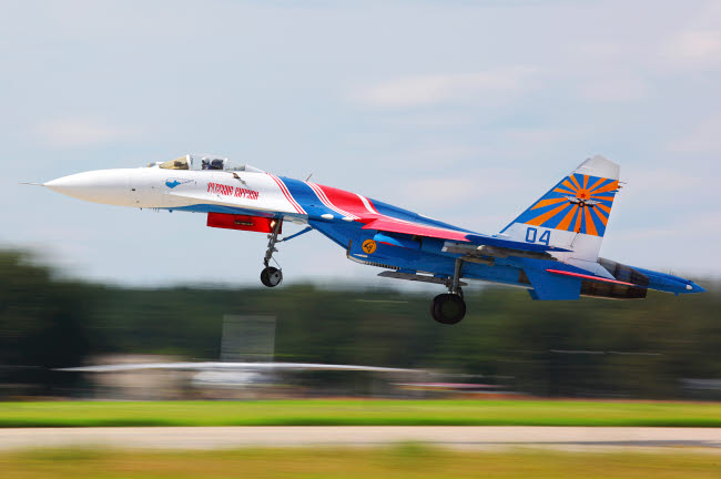 ANK100012M © Stocktrek Images, Inc. Su-27 jet fighter of the Russian Knights aerobatics team taking off.