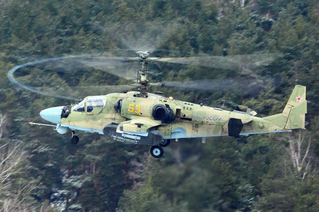 ANK100047M © Stocktrek Images, Inc. Ka-52 Alligator attack helicopter of the Russian Air Force taking off, Russia.