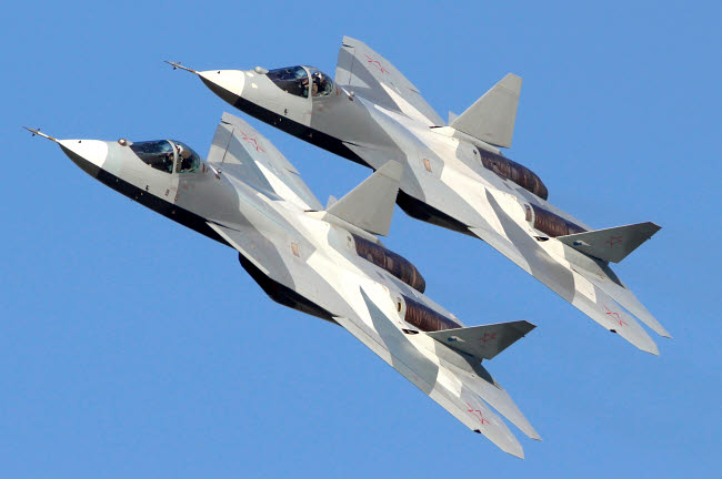 ANK100061M © Stocktrek Images, Inc. Pair of T-50 PAK-FA fifth generation Russian jet fighters.