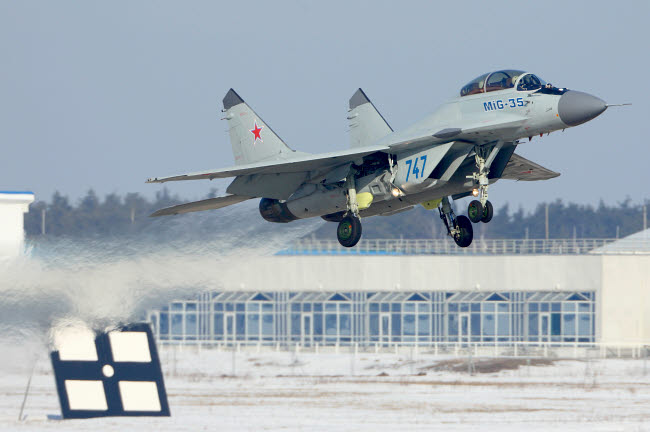 ANK100139M © Stocktrek Images, Inc. MiG-35 jet fighter of the Russian Air Force taking off, Zhukovsky, Russia.