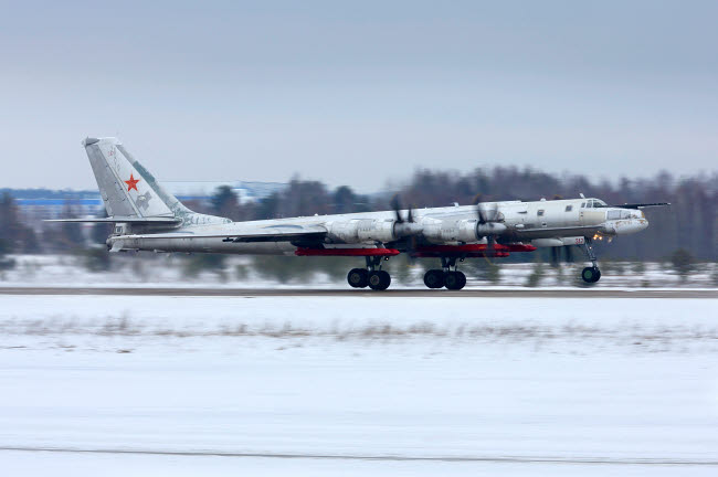 ANK100216M © Stocktrek Images, Inc. Tu-95MSM strategic bomber with X-101 missiles taking off for a test flight.