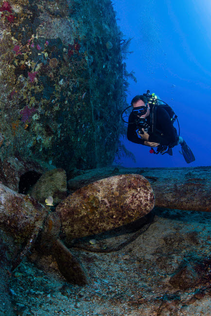 BRP400239U © Stocktrek Images, Inc. A diver observes the propeller of the Sea Star II shipwreck in the Bahamas.