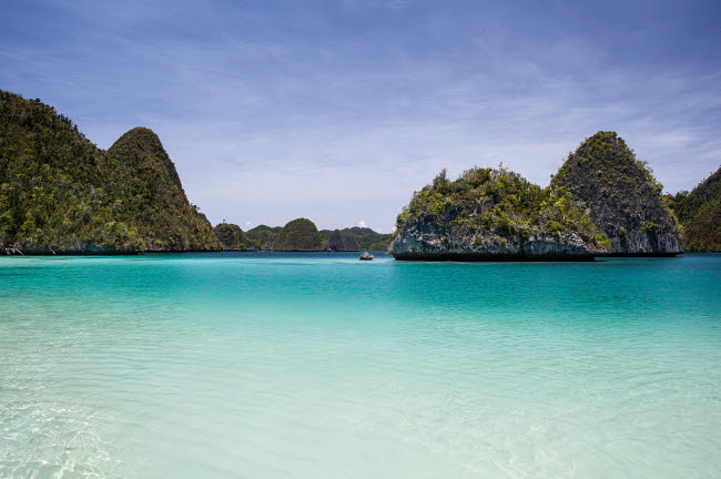 ETH400174U © Stocktrek Images, Inc. Rugged limestone islands surround a gorgeous lagoon in Raja Ampat.