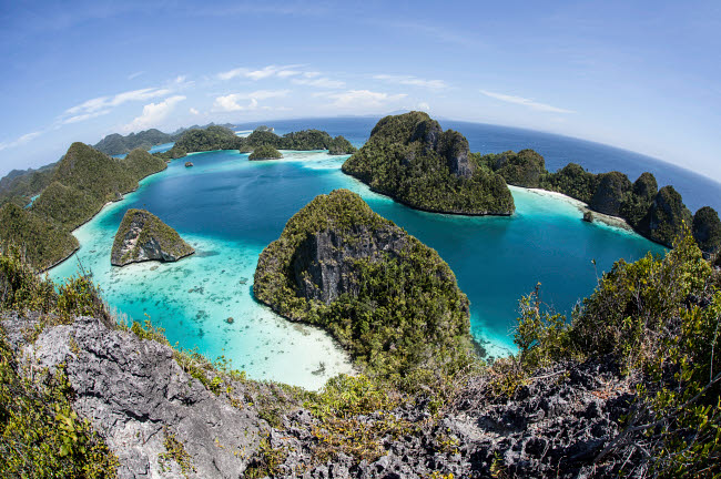 ETH400177U © Stocktrek Images, Inc. Rugged limestone islands surround a gorgeous lagoon in Raja Ampat.