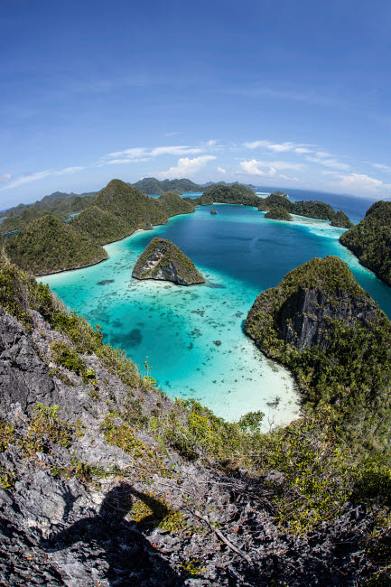 ETH400179U © Stocktrek Images, Inc. Rugged limestone islands surround a gorgeous lagoon in Raja Ampat.