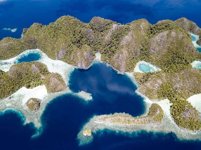 ETH401328U © Stocktrek Images, Inc. Aerial view of the limestone islands near Misool in northern Raja Ampat.