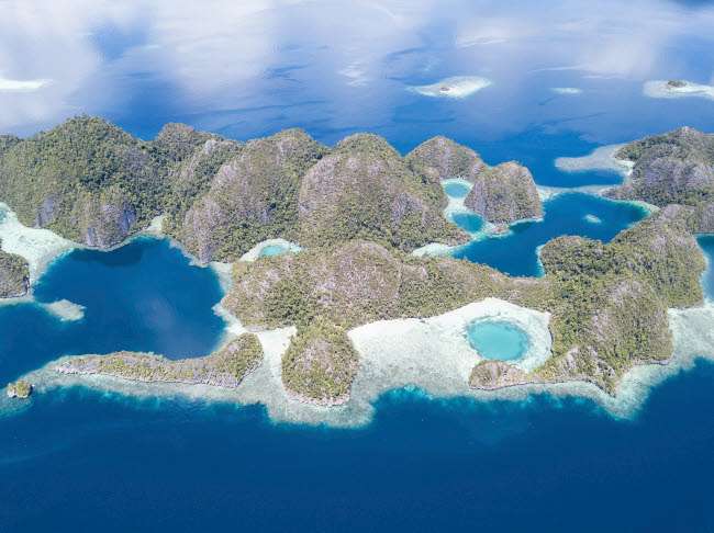 ETH401329U © Stocktrek Images, Inc. Aerial view of the limestone islands near Misool in Raja Ampat.