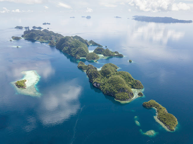 ETH401330U © Stocktrek Images, Inc. Aerial view of the limestone islands near Misool in Raja Ampat.