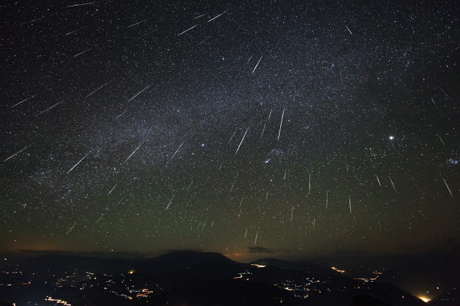 JFD200004S © Stocktrek Images, Inc. The Geminids meteor shower streaks across the clear sky above Yunnan province of China.