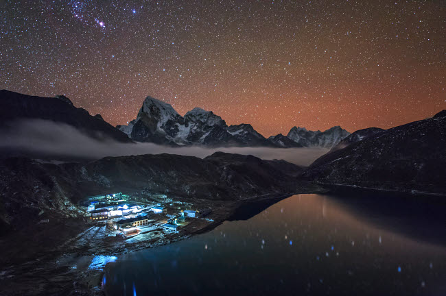 JFD200016S © Stocktrek Images, Inc. Starry night above Gokyo village in the Himalayas of Nepal.
