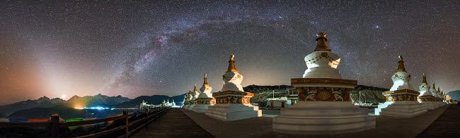 JFD200032S © Stocktrek Images, Inc. The night sky over a Buddhist shrine in Yunnan pronvince of China.