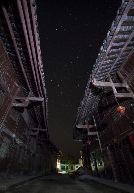 JFD200048S © Stocktrek Images, Inc. The Big Dipper seen through the alley way of a street in China.