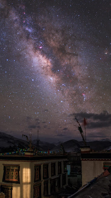 JFD200055S © Stocktrek Images, Inc. The Milky Way over a small vilage in Tibet, China